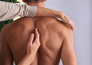 Man having chiropractic back adjustment close up. Osteopathy, Alternative medicine, pain relief concept